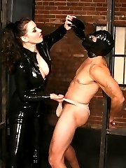 Sexy domme Anastasia Pierce bounds her slave with chains and duct tape before giving ass canning
