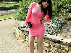 Cute brunette Elise works on your fetish wearing a tight pink summer dress and shiny black...
