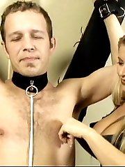 Mistress Nicolette plays with the nipples of her naughty slave before tying up his balls.