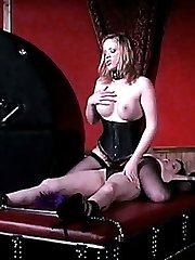 Sexy dominatrix Mistress Erzsebet playing with her big boobs as she face sits on her slave