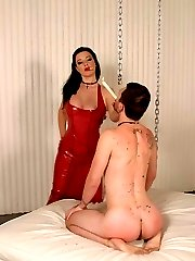 Sexy dominatrix Anastasia Pierce punishes her submissive partner with painful hot wax dripping