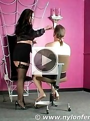 Nylon Mistress prepares her male slave for his transformation by applying makeup on him