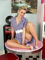 Anna is dressed up in a full skirted frock, some 1959 nylons and some pretty retro lingerie!