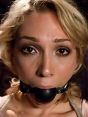 19 year old Lily LaBeau gets her first taste of BDSM and loves it! Her submission is...