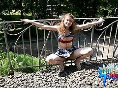 Young girl flashes her upskirt on railway bridge