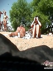 Nude spying camera tapes naked girls and their boyfriends sunbathing on nudist beach