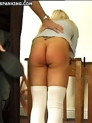 Two beautiful schoolgirls spanked and caned on their bared asses in the classroom