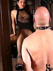 Jade reveals that she is a Dominatrix by night. Dressed in a sexy sheer outfit with fishnet...