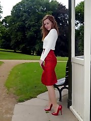 Hot red head Sophia steps out the office on her lunch break to parade around the park in a sexy...