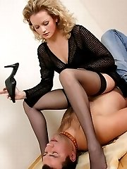 Being in bad mood Miss fucks slaves mouth with her shoes after a whip punishment.