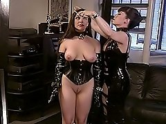 Girl-slave in corset and collar gets punished by her latex mistress with some tight bondage