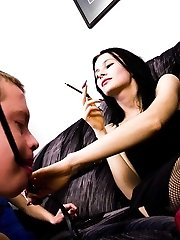 Two merciless dominas share their submissive foot-licking slaves with each other.