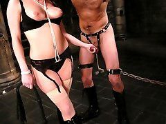 Mistress Harmony has a kept pet that she takes out to play with when she is feeling mean and horny.  Tonight, her mood is dark as she pulls 'lefty' from the cage and tests his resolve with her own style own pain, humiliation and sex.  Mistress toys with lefty's libido using CBT, whippings, bondage and ass fucking till she takes her fill of his hard cock to satisfy herself.  When she finally allows his come to spill, it is all over her beautiful body, and her boy toy is put away for another day's play.