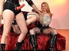 Strapon Jane and a guest femdom have a little fun with a silver haired TGirl slut.