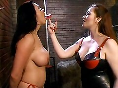 Busty lesbian gets bound and stripped to her g strings while a sexy Domme teased her