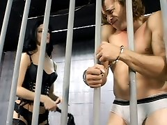Nasty dominatrix Leah Wilde bounds her naked slave to a prison cell bar and flags him in this BDSM movie