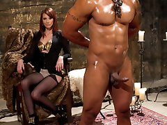 Maitresse Madeline allows Robert Axel to train with her on his very first day with Divine Bitches! This lucky muscular piece of man meat is used to women fawning all over him and thinks that because Maitresse has allowed him the honor of worshiping her on his very first training day that he'll win her over just as he always does with the ladies. Robert's in for a rude awakening when Madeline strips him of his ego and declares him the official Divine Meat. Madeline is going to pass this one around to all her Divine girlfriends just for the amusement. Robert is whipped and has his cock and balls tortured. He's teased by Madeline's beauty and his cock remains hard the entire time! Can you blame him? She fucks his ass deep and uses her magic fingers to milk his prostate until his cock erupts with filth uncontrollably. Still, his cock remains hard! She uses him like a pony riding him around the basement, making him worship, lick and clean her asshole while she comes. It's safe to say the other Bitches are going to have a field day with this one and we will just have to wait and see how he turns out in the end!