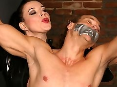Mistress Anastasia muffles her screaming malesub by choking his mouth with a duct tape