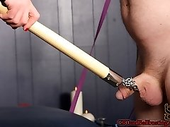 Mistress Cheyenne leads slave will in by a chain around his cock. She then straps him into a...