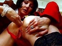 Lesbians having an intense ass fisting session