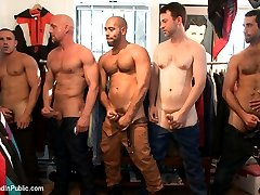 There's a clothing shop in SF where the customers are always ready for some action. Leo Forte brings in his boy of the day, Jordan Foster, to be a piece of it. With the shop owner's permission the guys put Jordan to work making him suck cock right away. Stripped down to his underwear he jacks guys off two at a time while keeping two more cocks in his mouth. A stranger grabs him and fucks him in front of the window as unassuming people walk down the street. Jordan gets thrown into the dressing room to beg for cock and receive loads before another fuck and more hot loads from strangers.