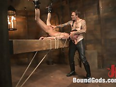 Arms bound high above his head, Chris Harder, now Slave #401, struggles to stand at attention in the presence of his dom, Christian Wilde. Mr. Wilde gives a full inspection of #401 and reminds the new slave of his responsibilities: hard cock, clean ass and clear mind. With those expectations made clear, Mr. Wilde works #401 into an erection before cropping him viciously. He has the slave clean his boots and cock, still laying down a brutal cropping. #401 maintains a hard-on through this treatment, so Mr. Wilde binds the slave to a horizontal beam to inspect his ass. Sufficiently clean, Mr. Wilde fucks #401 relentlessly before suspending #401's legs above his head, helpless to escape a hard flogging. Mr. Wilde then chains #401 over a cage and continues fucking the slave. #401 offers deep, vocal gratitude for Mr. Wilde's massive cock and the hot wax poured onto his chest and back. With #401 painted red and black by the wax, Mr. Wilde fucks the cum out of him and smears the slave's load all over his face. Mr. Wilde finishes with his own load into the slave's mouth, promising more in the days to come.
