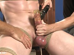 Today for Men on Edge we brought in Cass Bolton for a hot and heavy edging session. Sebastian and Jessie get straight on work on the jock, tying him tight to the windows and having his massive cock and balls bulge from silicone rings. Jessie's mouth and a double hitachi treatment gets Cass moaning for an orgasm, but the two won't let him cum that easy. The boys flip Cass around and fuck his ass with an electrostim vibe and give the painslut a little taste of the flogger. Next, Cass is bound to a chair, a rope from the floor squeezing his balls. The boys worship Cass' feet before moving their attention back to his crotch. Jessie provides some CBT while Sebastian teases Cass with the vibrating sheath. At long last, Sebastian and Jessie feel generous enough to let Cass cum, but not without a cruel post-orgasmic torment and flogging.