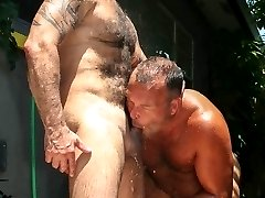 Take a sneak peak behind the scenes at a Bear Films video shoot when muscle bear Steve King and Big Daddy Brock Hart cool off under a shower after an afternoon of fucking under the hot Florida sun. Their scene appears on our new DVD Bear DNA 2, set for release later this month, but we wanted to tease you with some hot action that took place after we thought these two horny bears were finished. ...