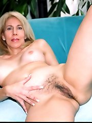 Older lady unveils hairy bush and lets black man assfuck her!