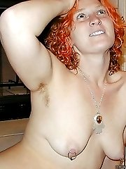 Flexible redhead does not shave her pits or pussy