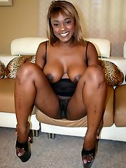 Ebony chick Coco Rosy flaunts her humongous titties and takes in a hard impaler in her unshaved gash
