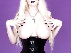 stacked goth blonde in latex corset and stockings
