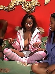Horny dark-hued lesbians having a threesome