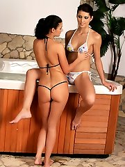 Lesbian lovers enjoy a hot tub fuck