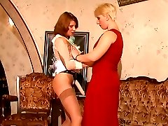 Nylon clad mature chick giving a sexy blonde girl some hot pussy massage