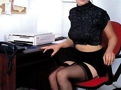 Secretary with black stockings on the phone