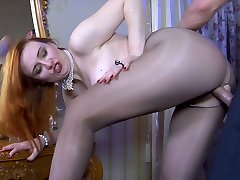 Horny redhead spots a big boner and goes for kinky through pantyhose sex