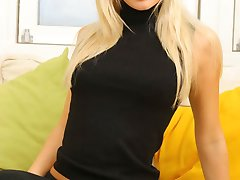Gorgeous blonde Sam K in black secretary outfit with stockings