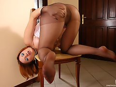 Spicy bride tearing her smooth hose burning with desire to stroke her pussy