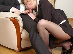 Extremely sexy secretary getting her pantyhose clad feet licked fervently