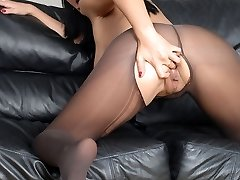 Gorgeous dark-haired Amber Leigh just drilling trickles SEX as she dons her fave pair of ultra sleek black nylons!, Amber's curvacious body looks nothing short of sensational in her assets hugging nylons