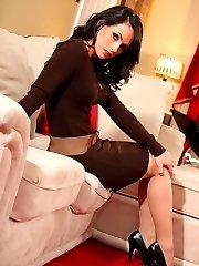 Anastasia looks incredible in her tfigure hugging brown dress and heels.