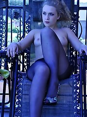 Tasty blondie strips off outdoors and slides her hand under the black hose