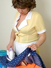 Mature French maid in silky pantyhose ironing before gagging on beefy meat