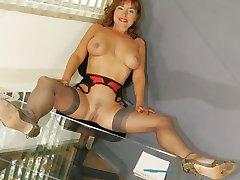 Busty secretary in stockings