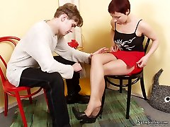 Cute gal in lacy tights seducing kinky guy dangling her open platform shoes