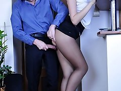 Raunchy gal in a mini-skirt and sheer dark pantyhose fucked by a co-worker