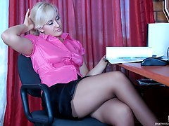 Fiery business lady takes a break shoving a dildo under pantyhose waistband