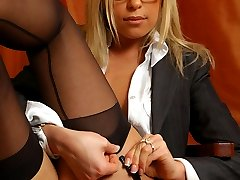 Secretary changing her broken stockings for new black full-fashioned ones