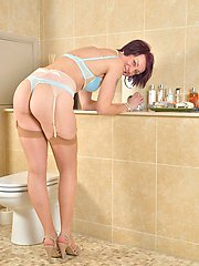 Older babe Penny Brooks toys pussy in the bathroom.
